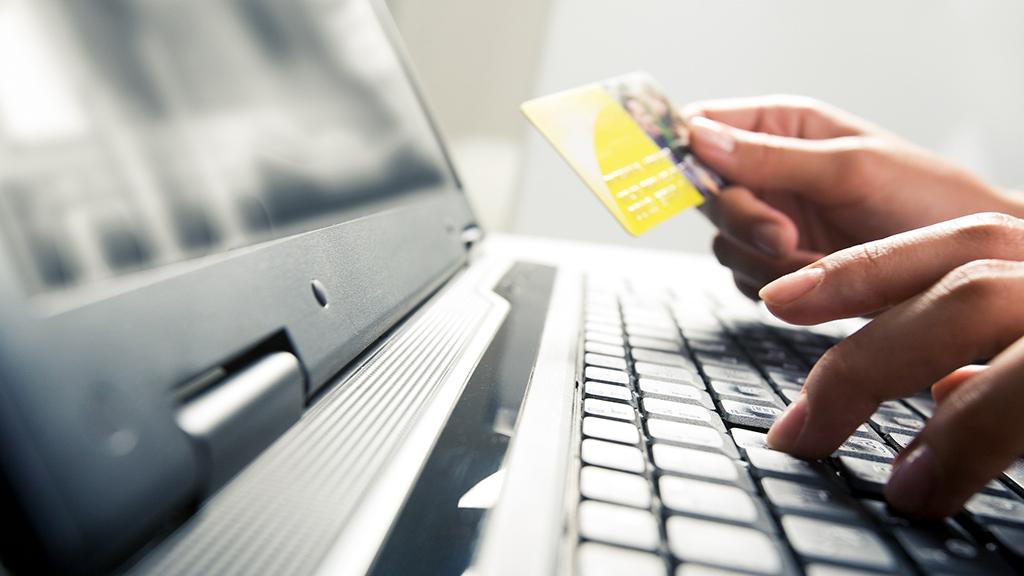 Ecommerce shopper holding credit card